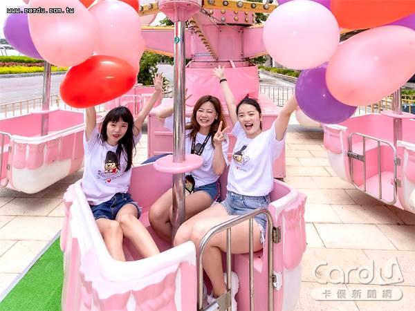 淡水漁人碼頭前舉辦夏日粉紅樂園,以粉嫩色系相關遊樂設施,吸引網美拍照打卡(圖/福容大飯店 提供)